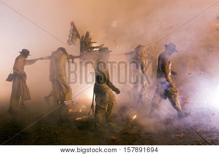 Night religious procession under full smoke of firecrackers during the Phuket vegetarian festival, Thailand