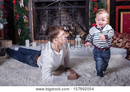 Dad and son preparing for the holiday season