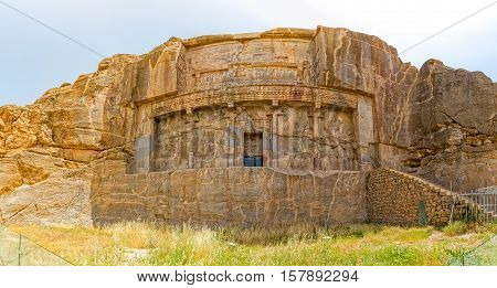 Royal tombs ruins on the hill in old city Persepolis, a capital of the Achaemenid Empire 550 - 330 BC.