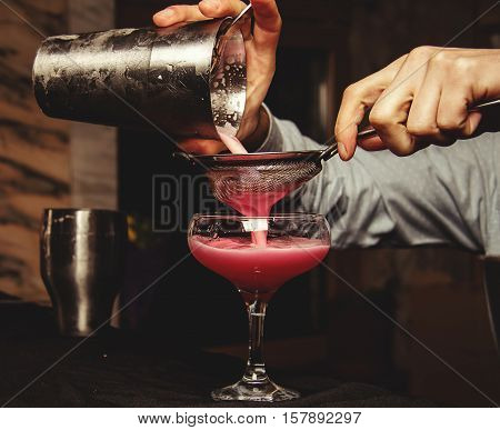 Bartender making a cocktail in a restaurant