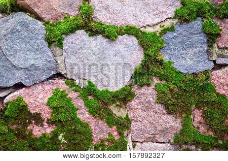 Mossy wall from stones and cement background concept