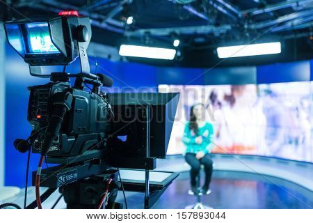 Closeup of a Video Camera Filming a TV Host