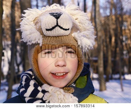 preteen handsome boy in funny lion hat close up portrait