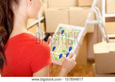Woman with tablet at warehouse. Map with marks on screen. Logistics concept.