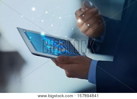 Male hands with tablet, closeup. World map with delivery network on screen. Logistics concept.