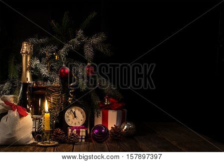 Conceptual background for Christmas or New Year. Champagne in glasses with candles. Copy-space.