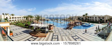SHARM EL SHEIKH EGYPT - NOVEMBER 30: The tourists are on vacation at popular hotel on November 30 2013 in Sharm el Sheikh Egypt. Up to 12 million tourists have visited Egypt in year 2013.