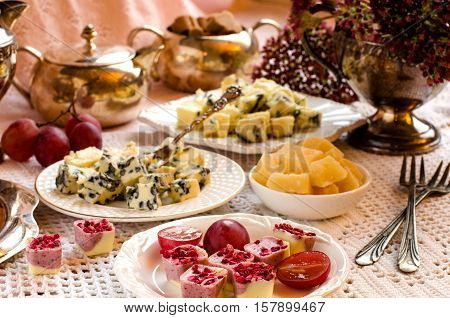 Beautiful Table Setting With Desserts And Cheeses.