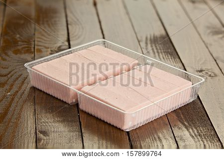 Delicious  Strawberry Paste  On Plate On Wooden