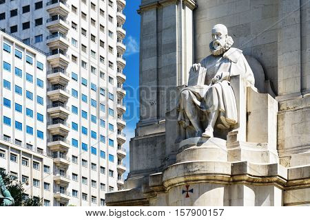 View Of The Stone Sculpture Of Miguel De Cervantes On The Square Of Spain (plaza De Espana) In Madri