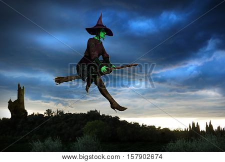 3D illustration of a witch with glowing eyes flying on broomstick in front of a dramatic evening sky.