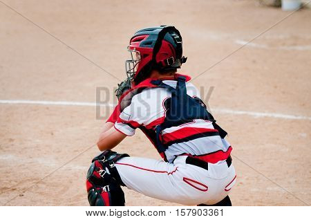 American baseball player behind home plate during a game.