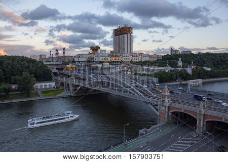 Russian Academy of Sciences building and Andreevsky bridge at evening, Moscow, Russia
