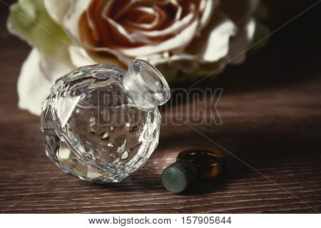 Perfumery. Small bottle of female perfume with flowers