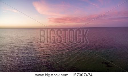 Aerial View Of Sunset Over Ocean. Nothing But Sky, Clouds And Water. Beautiful Scene