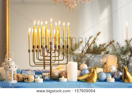 Menorah and decorative elements near mirror. Hanukkah concept