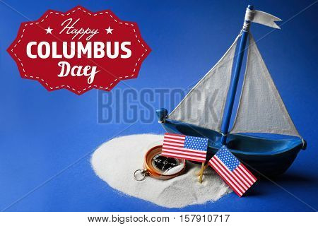 Text HAPPY COLUMBUS DAY with wooden boat and compass on blue background. National holiday concept.