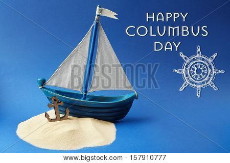 Text HAPPY COLUMBUS DAY with wooden boat on blue background. National holiday concept.