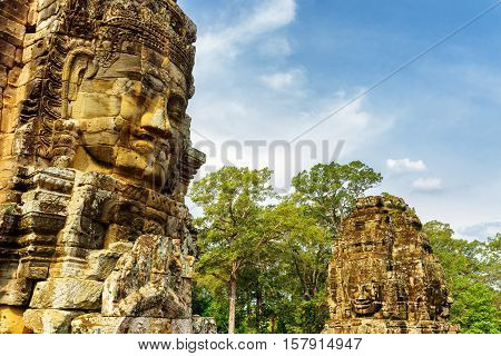 Enigmatic Giant Stone Faces Of Ancient Bayon Temple In Angkor