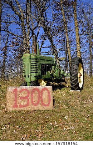 BATTLE LAKE, MINNESOTA,  June 19, 2016:  The old collector tractor for sale is a product of John Deere Co, an American corporation that manufactures agricultural, construction, forestry machinery, diesel engines, and drivetrains.