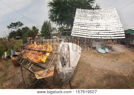 Traditional of Solar-Barbecued pork from a glass.