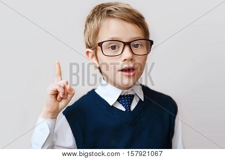 schoolboy raising his hand to give an answer