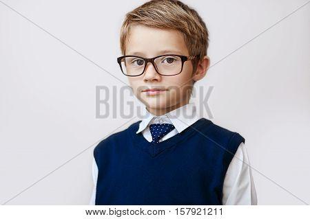 Looking at camera. School concept. Back to School. school uniform