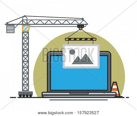 Website Construction Concept, construction crane lifting image placeholder to a laptop  notebook computer screen