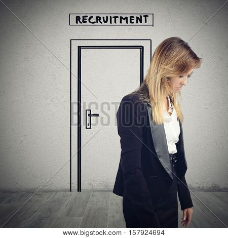 Woman exits from the room of recruitment sorrowfully because she is not hired