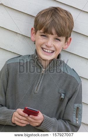 Boy child using mobile cell phone