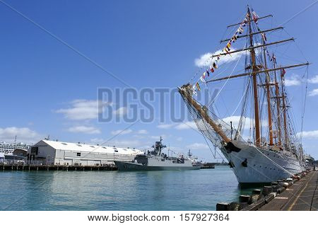 AUCKLAND - NOV 20 2016: The Bark Esmeralda steel-hulled four-masted barquentine tall ship of the Chilean Navy arrives at Auckland New Zealand as part of the NZ Navy's 75th birthday celebrations.