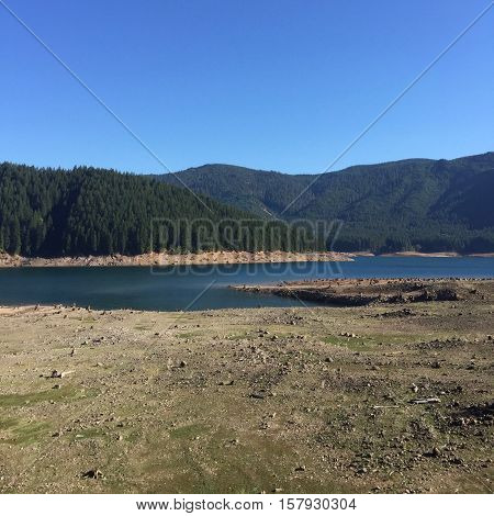 The empty banks of Detroit Reservoir in Oregon show how empty it gets after irrigation season.