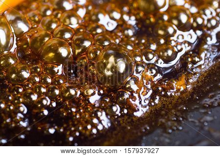Close up of soy sauce bubbling in a frypan