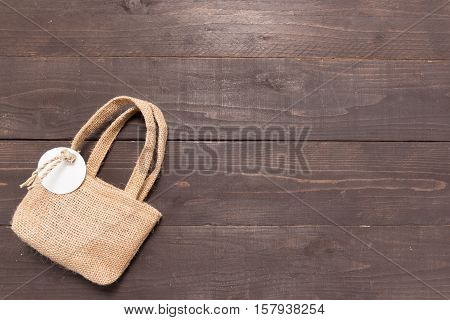 Hessian Sack Bag Is On The Wooden Background With Tag