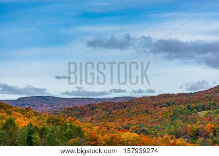 Looking over the hillsides of Vermont during fall foliage season