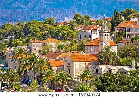 Splitska village stone landmarks in palm trees island of Brac Croatia