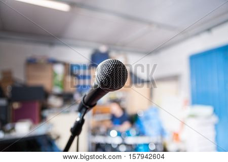 close up of a microphone on a band rehearsal place with a very shallow depth of field color version