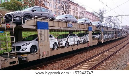 PILSEN CZECH REPUBLIC - NOVEMBER 21, 2016: Cargo train with new cars Hyundai Tucson going to Germany. Product of Hyundai Motor Manufacturing Czech s. r.o. in Nosovice. Czech automotive industry.