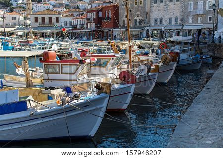 Old boats at the pier of Hydra island, Greece.