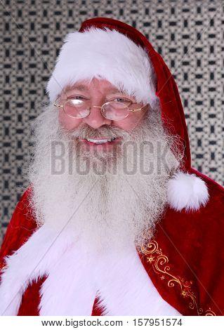 Santa Claus Head Shot. Santa Headshot. Santa Claus Studio Head shot. Head shot in black and white. Smiling Santa Claus.