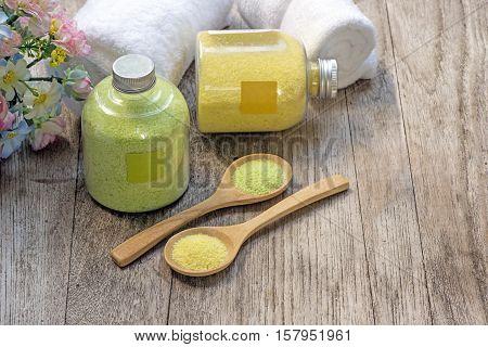Homemade scrub made of sea salt and lemon on wooden background.