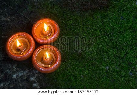 Orange Candle and beeswax warm light in dark