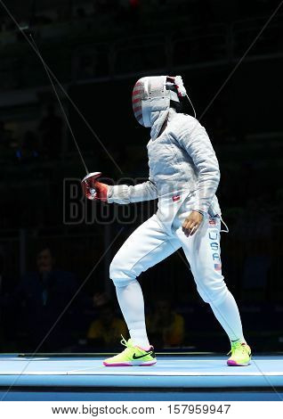RIO DE JANEIRO, BRAZIL - AUGUST 13, 2016: Ibtihaj Muhammad of United States competes in the Women's Sabre Team of the Rio 2016 Olympic Games at Carioca Arena 3