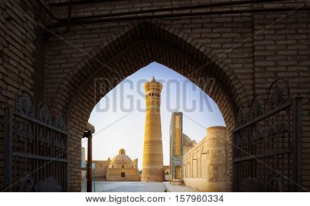 Yard of Poi Kalyan oriental complex at sunrise. View from the gate. Bukhara, Uzbekistan