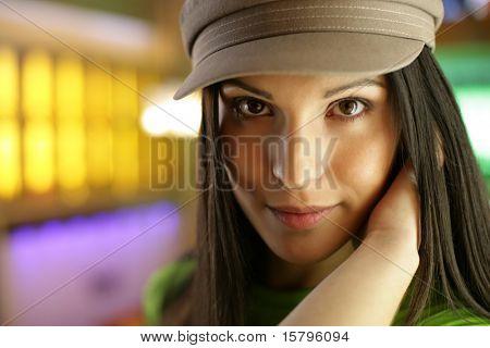 Beautiful young woman looking at camera, close-up. Shallow DOF.