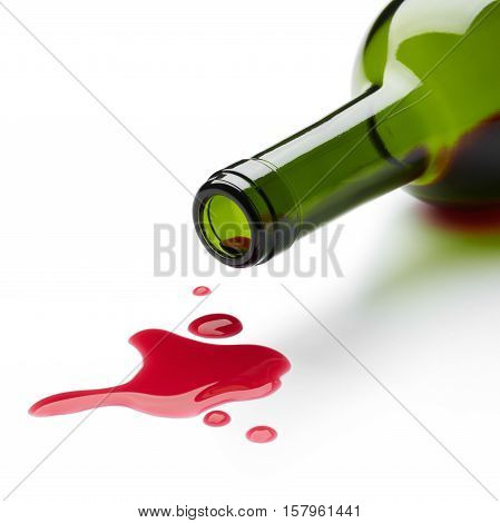 red wine spilling out from the bottle