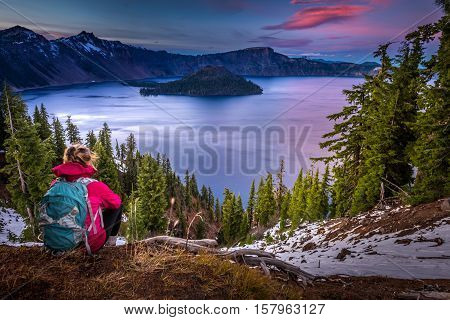Tourist Looking At Crater Lake Oregon Landscape
