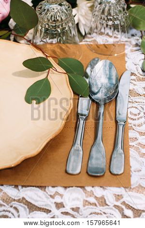 Silverware with porcelain plate on table, flat lay. Rich luxury dinner. Restaurant serving for banquet. Rank and fashion lifestyle concept