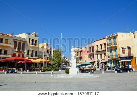 RETHYMNO, CRETE - SEPTEMBER 15, 2016 - Statue to the unknown soldier in Agia Stratiota Square (Agnostou Square) with pavement cafes to the rear Rethymno Crete Greece Europe, September 15, 2016.