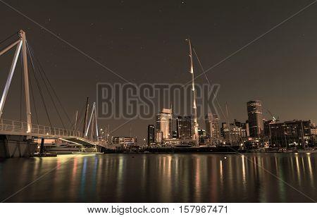 Auckland Skyline reflecting on Westhaven Marina. Toned Image